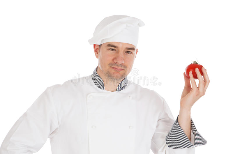 Шеф-повар держа свежий томат стоковая фотография