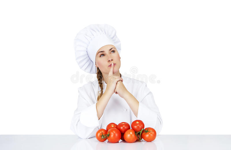 Шеф-повар молодой женщины показывая томаты для итальянской еды на белизне стоковые фото