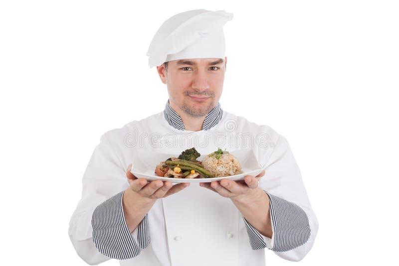 Шеф-повар показывая и держа плиту подготовленной еды стоковые фото