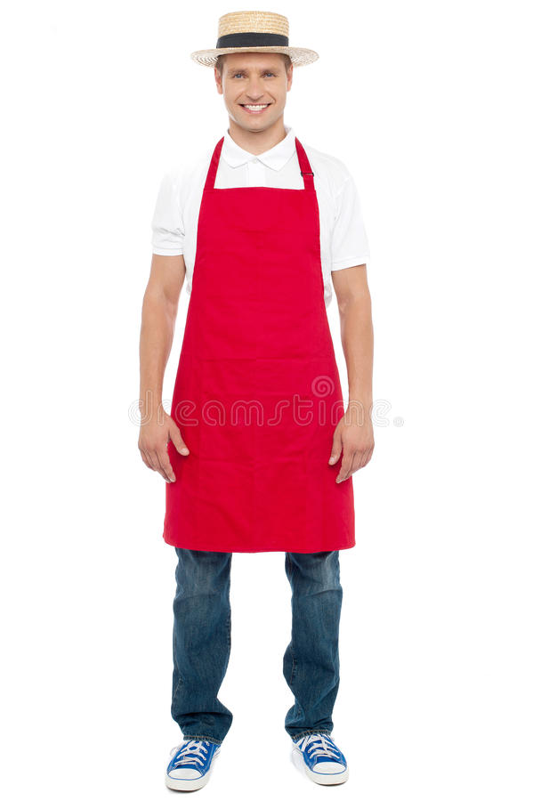 Шеф-повар при шлем изолированный против белой предпосылки стоковое изображение