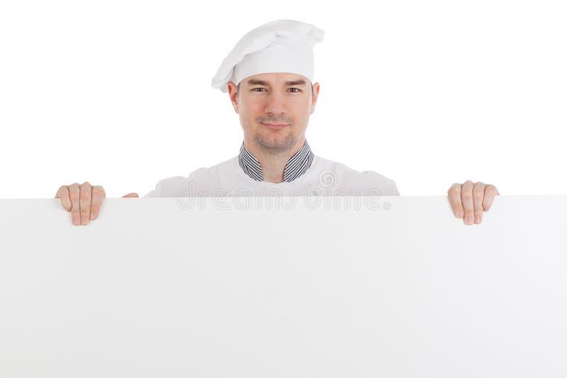 Шеф-повар с белой пустой доской стоковые изображения rf