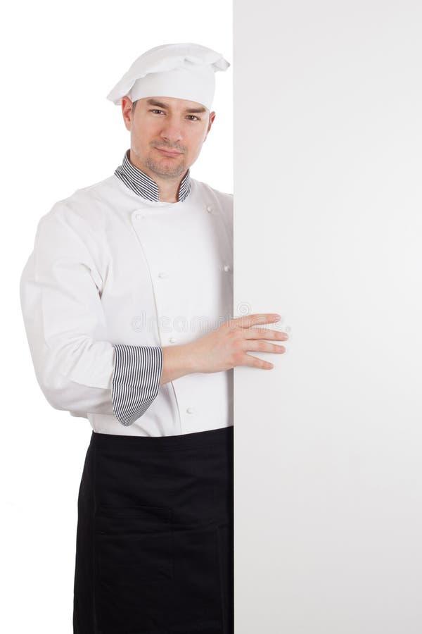 Шеф-повар с белой пустой доской стоковые изображения