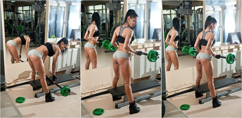 Шикарное брюнет работая на ее мышцах в спортзале, отражение зеркала Женщина фитнеса делая разминку Sporty девушка делая тренировк стоковое изображение rf