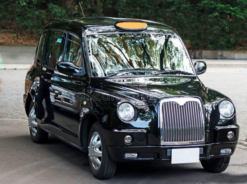 Шикарное черное такси Лондона стоковые фото