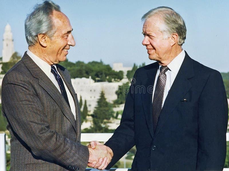 Шимон Перес приветствует Джимми Картера в Иерусалиме стоковое фото rf