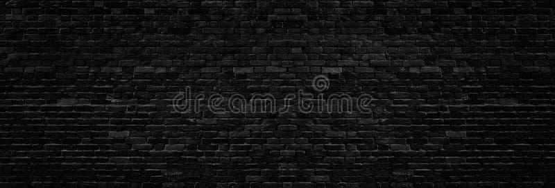 Широкая старая черная текстура кирпичной стены Темная панорама masonry Предпосылка grunge кирпичной кладки панорамная бесплатная иллюстрация