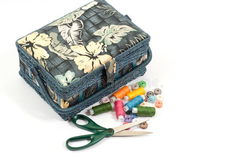 шить ножниц голубой коробки стоковое изображение