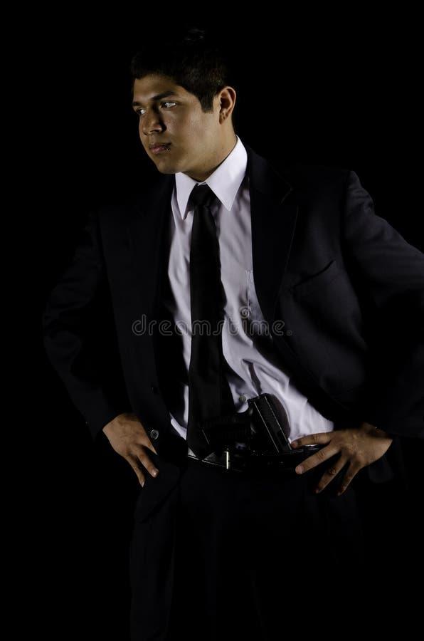 шкафут связи костюма человека пушки полосы черный стоковые изображения
