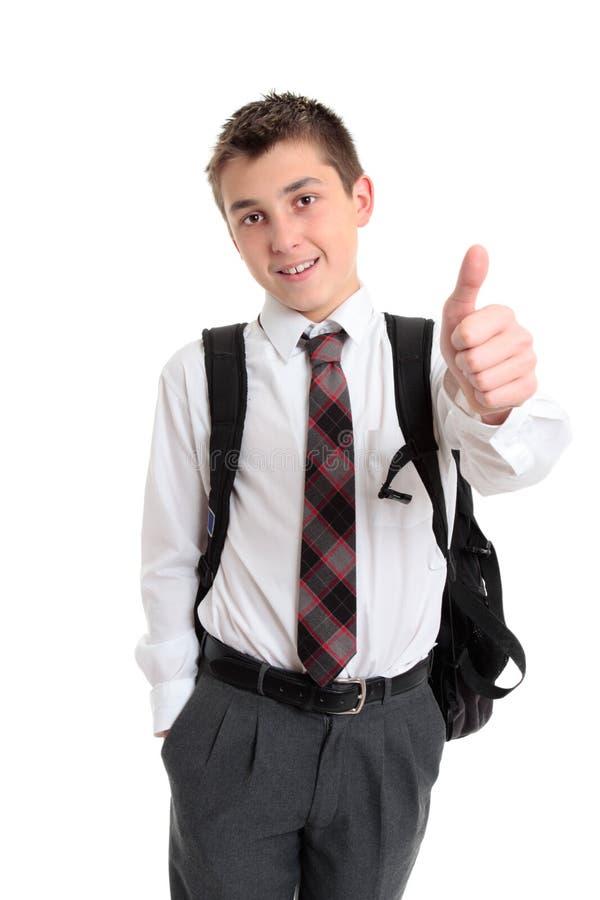 школа руки мальчика показывая большие пальцы руки знака вверх стоковые изображения