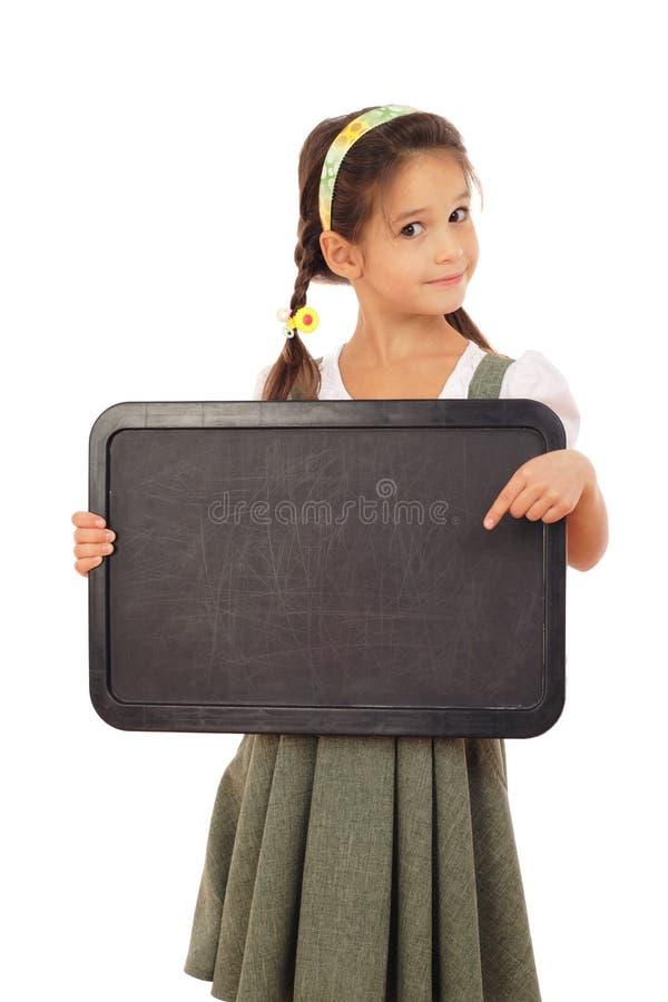 школьница chalkboard пустая маленькая указывая к стоковое изображение