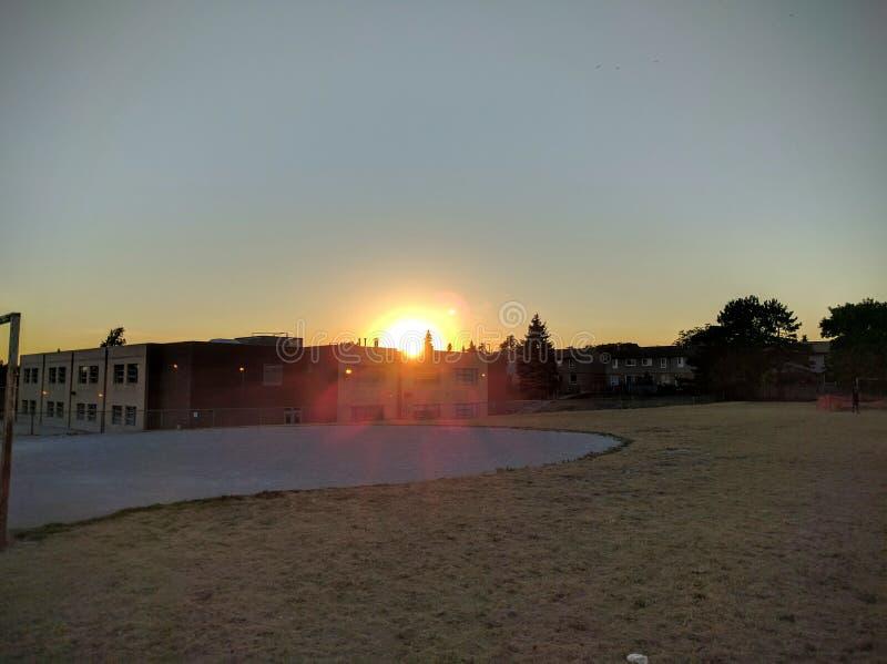 Школа в заходе солнца стоковая фотография rf