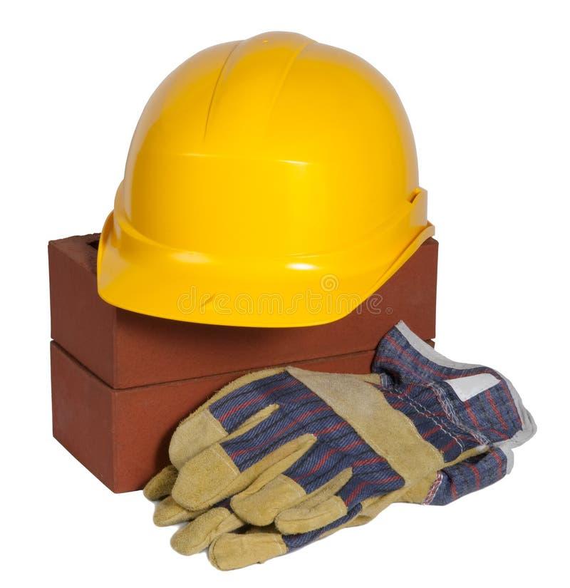 шлем перчаток кирпичей трудный стоковое фото