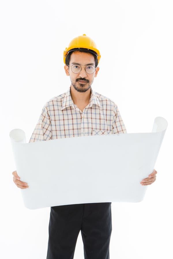 Шлем положения человека инженера желтый стоковое фото rf