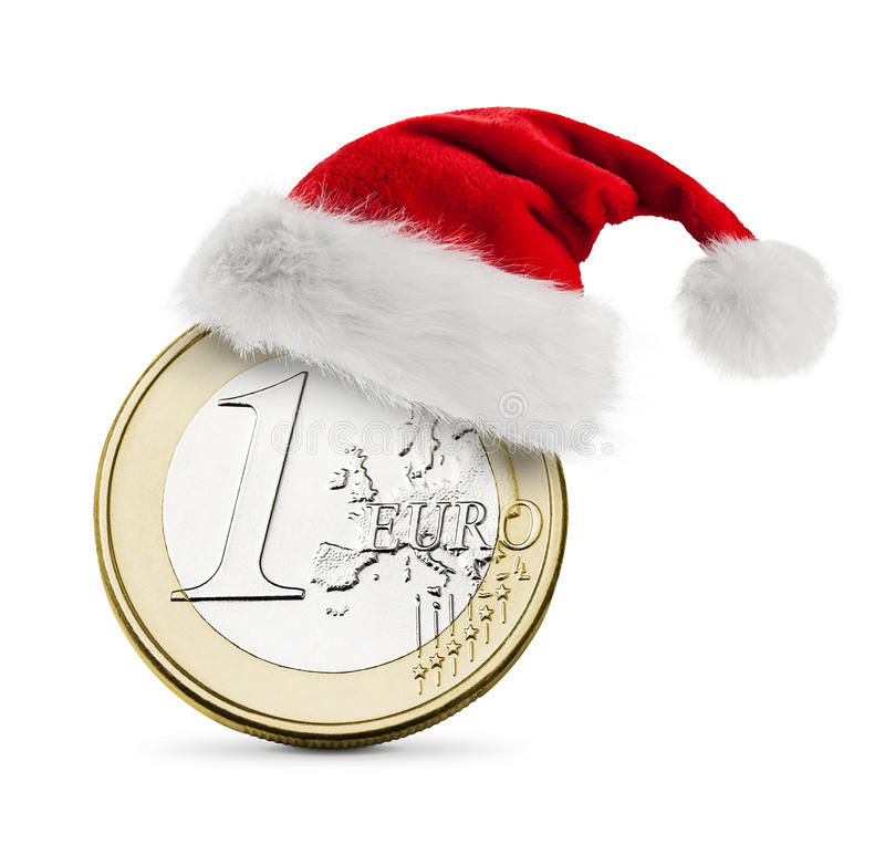 Шлем Санта и одна монетка евро стоковое изображение rf