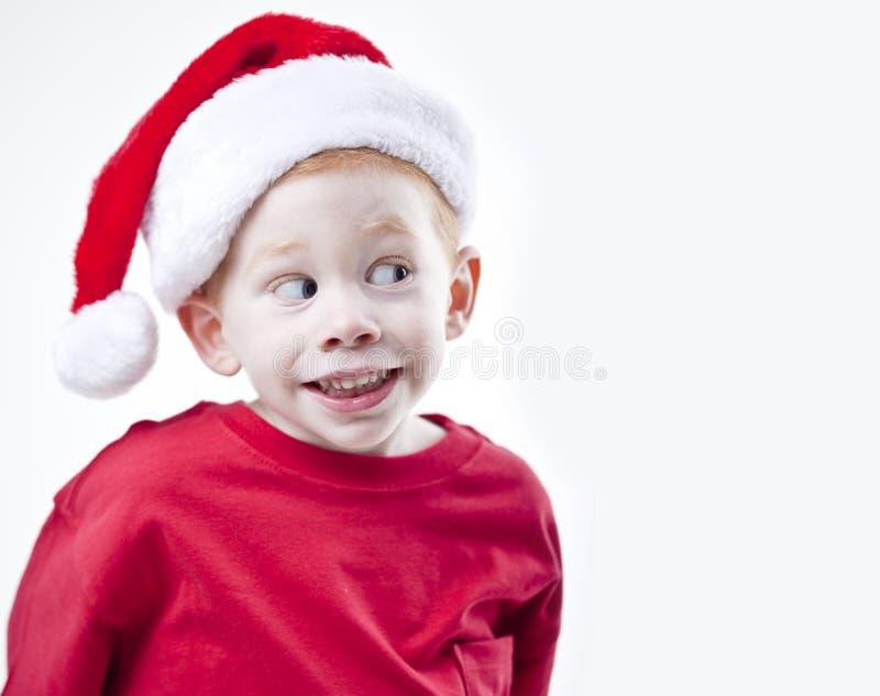 шлем santa мальчика стоковая фотография