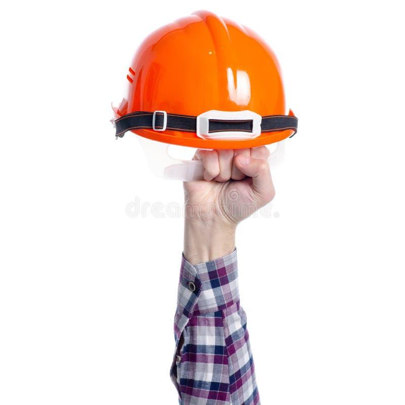 Шляпа шлема трудная в руке стоковые изображения rf