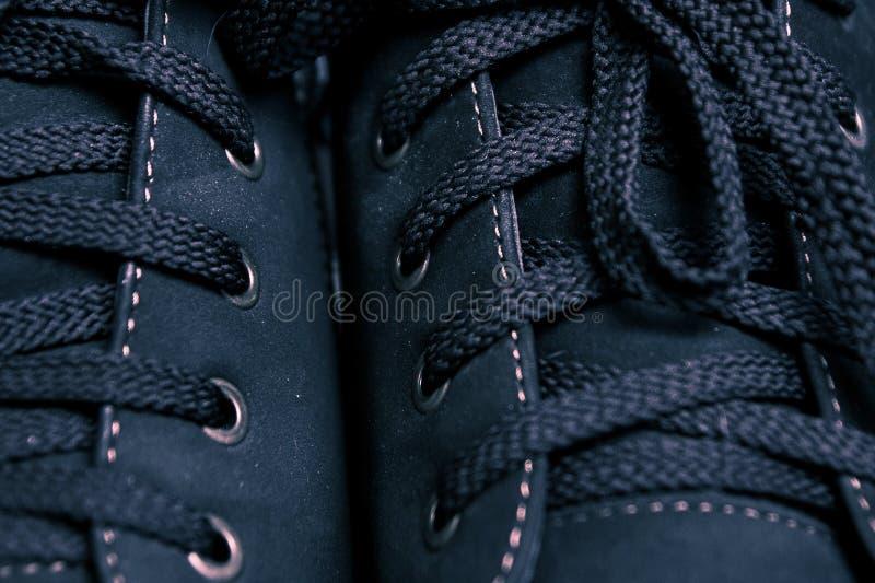 Шнурок и ботинки стоковые фото