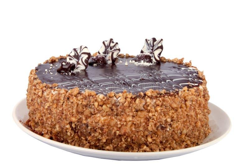 Шоколадный торт при изолированная вишня стоковое изображение rf