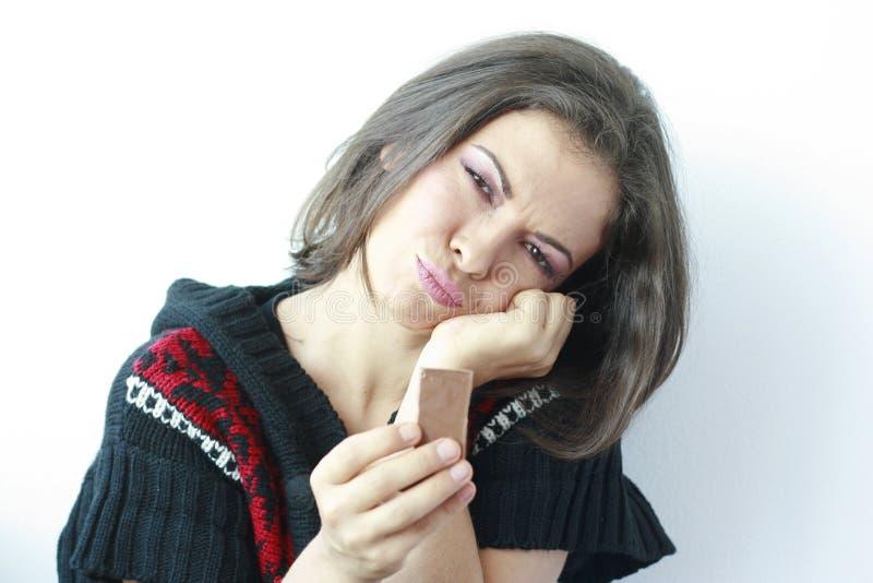 шоколад вручает ее женщину части унылую стоковые изображения rf