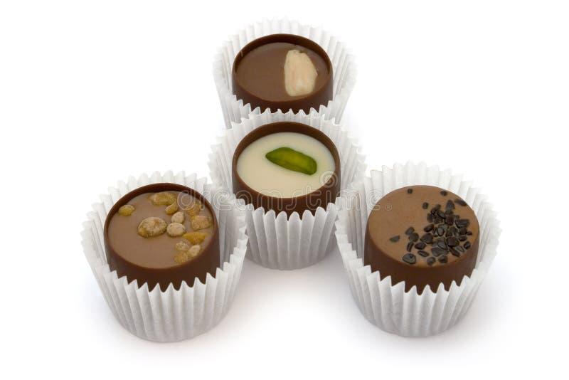 шоколад 4 конфеты стоковое фото rf