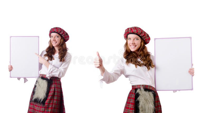 Шотландская женщина с доской на белизне стоковая фотография