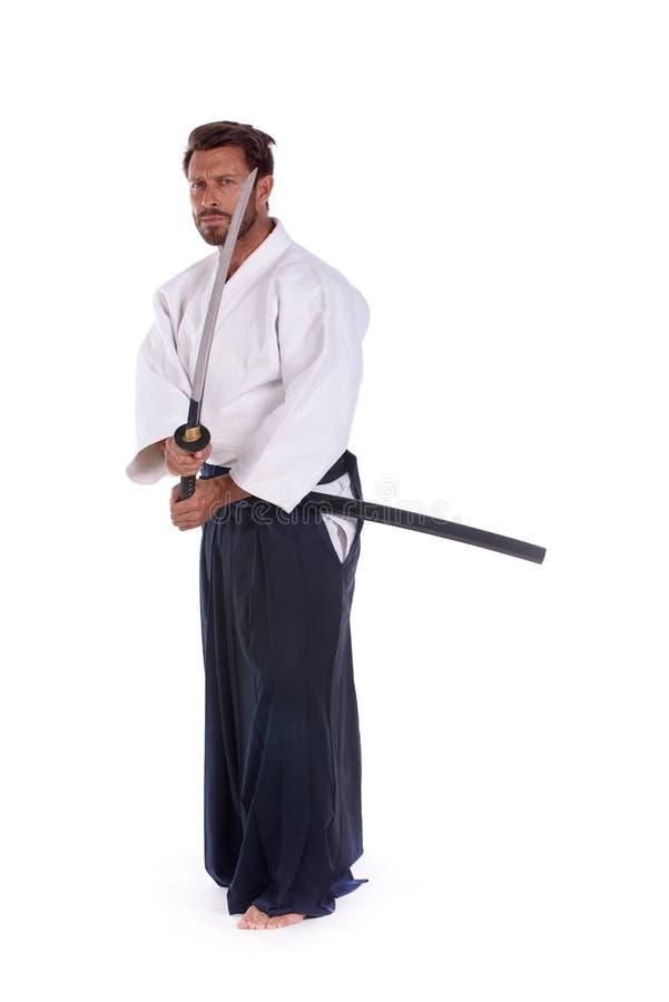 Шпага woth тренировки mastrer айкидо стоковая фотография