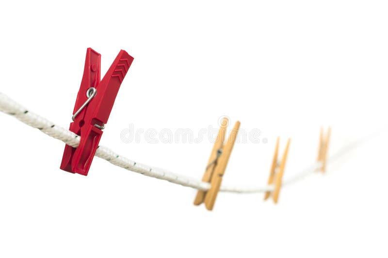 Шпеньки на веревочке стоковая фотография rf