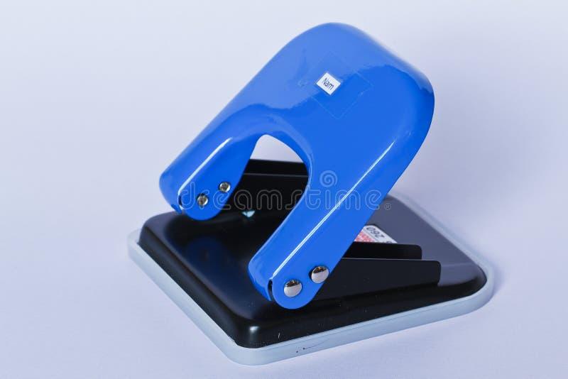 Штамповщик голубой бумаги стоковая фотография rf