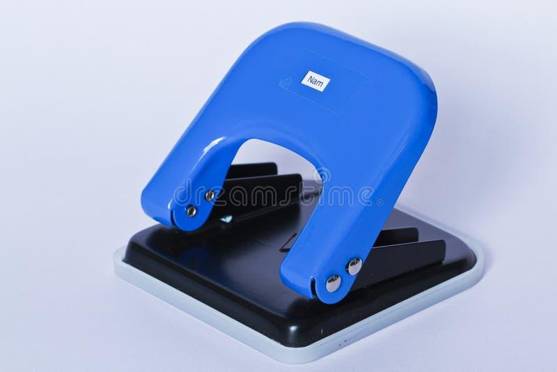 Штамповщик голубой бумаги стоковое изображение