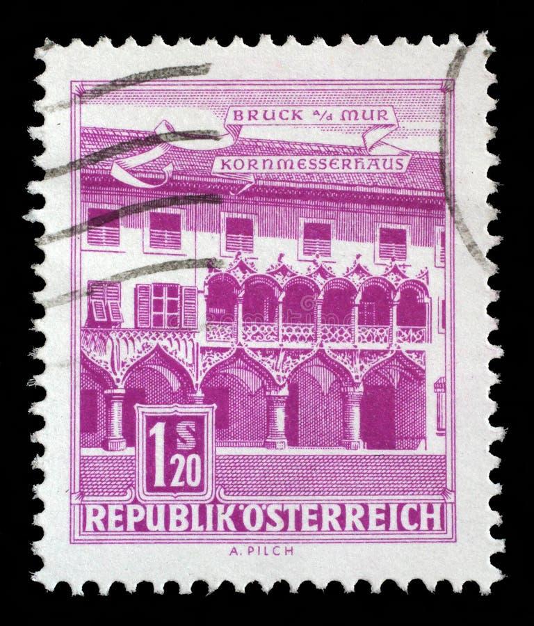 Штемпель напечатанный в Австрии показывает дом Kornmesser, Bruck на Mur стоковая фотография