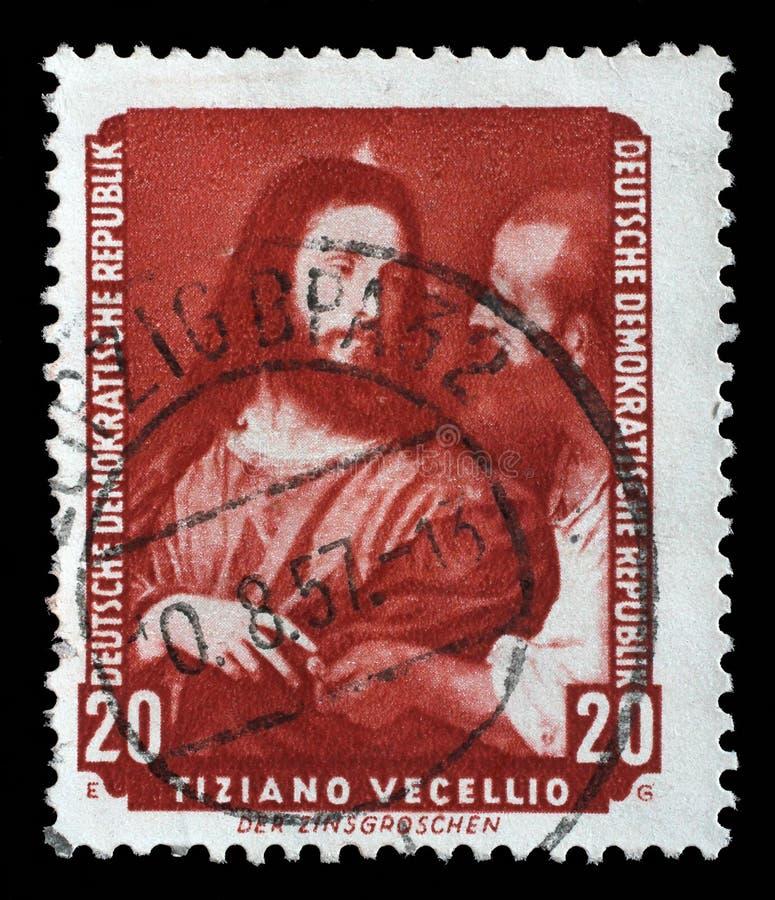 Штемпель напечатанный в ГДР показывает что налог картины омедняет, Tiziano Vecellio стоковые изображения