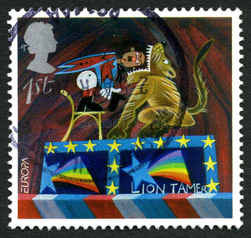 Штемпель почтового сбора Великобритании льва более Tamer стоковое изображение rf