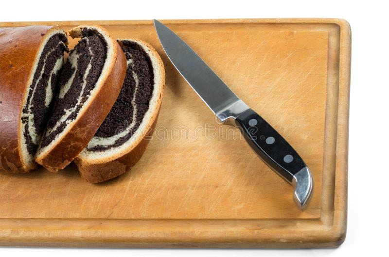 Штрудель макового семенени и нож стоковая фотография