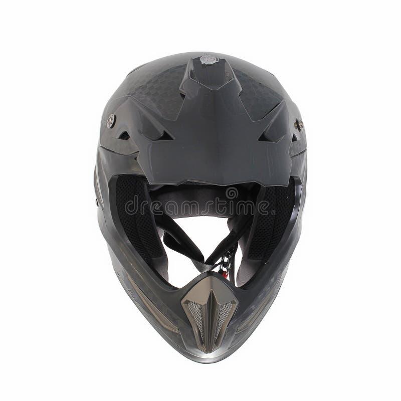 Шлем мотоцикла Motocross изолированный на белой предпосылке, черноте, сияющем волокне углерода стоковое изображение rf