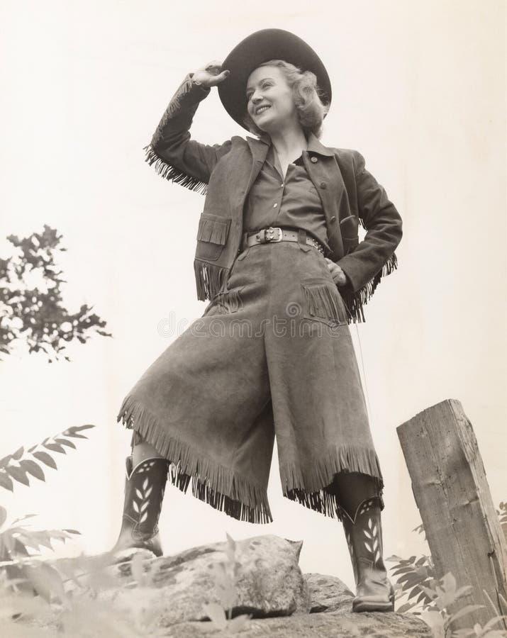 шлем пастушкы ее наклонять стоковая фотография rf