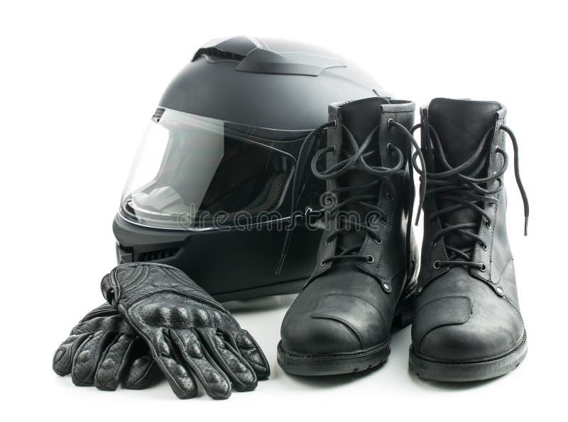 Шлем, перчатки и ботинки мотоцикла стоковое изображение rf