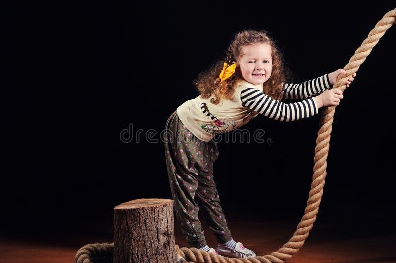 Що»pretty little girl. Pretty little girl on the studio background, white, beautiful, child, person, happy, childhood, smile, small, young, fashion, kid royalty free stock photography