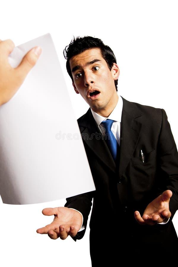 ый бизнесмен босса получающ его детенышей стоковое изображение rf