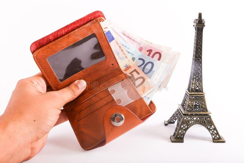 Эйфелева башня с банкнотами евро стоковые фотографии rf
