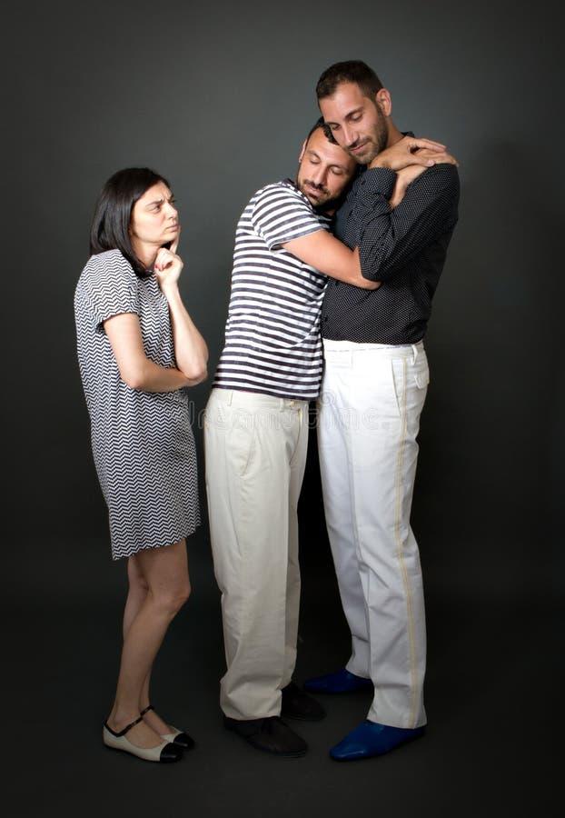 Эксцентричные голубые пары с недоверчивый подругой стоковое изображение