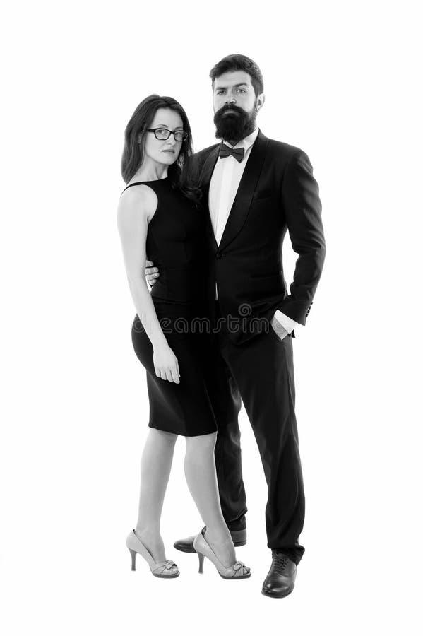 Элегантная женщина и бородатый джентльменский черный смокинг с галстуком-бабочкой Официальное событие Правила кода сопоставления  стоковая фотография
