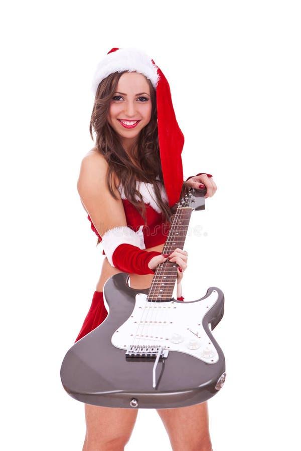 электрическая давая женщина santa гитары вы стоковое изображение rf