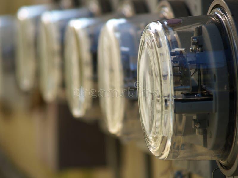 электрические счетчики рядка стоковая фотография