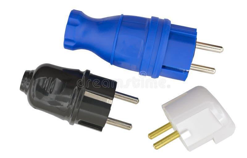 Электрические штепсельные вилки на белизне стоковое изображение rf