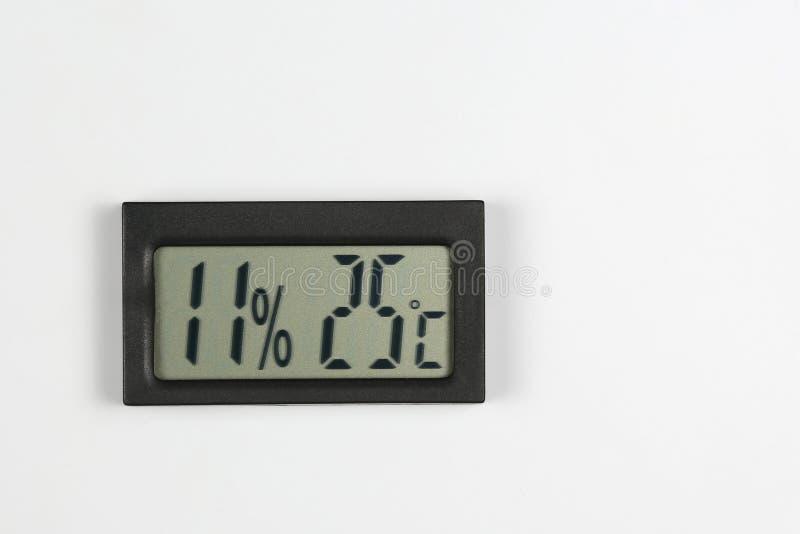 Электронные метр и температура влажности на белой предпосылке стоковые изображения rf