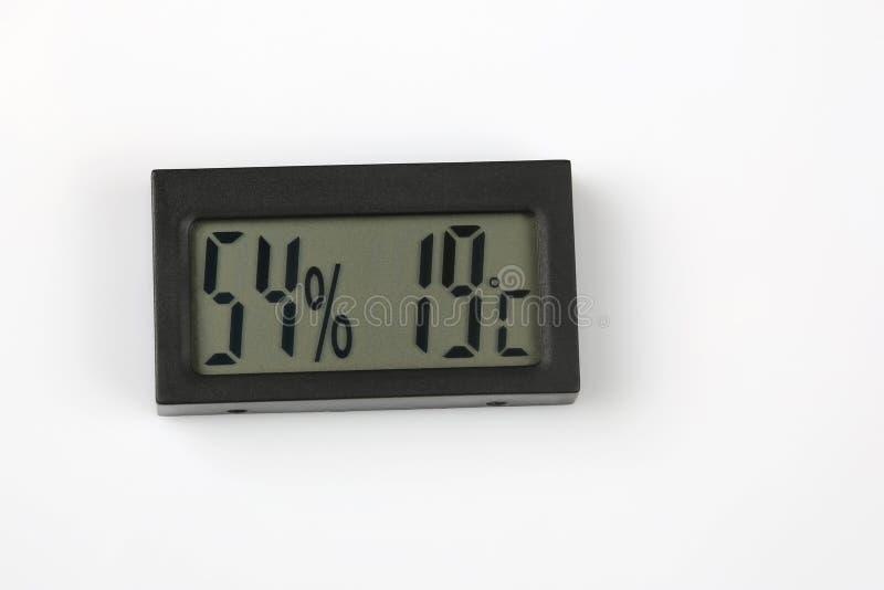 Электронные метр и температура влажности на белой предпосылке стоковые фотографии rf