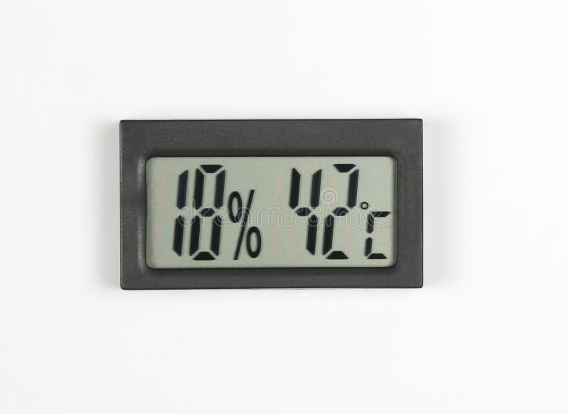 Электронные метр и температура влажности на белой предпосылке стоковое изображение