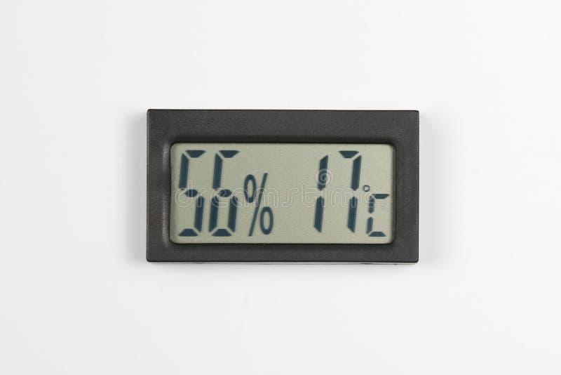 Электронные метр и температура влажности на белой предпосылке стоковое изображение rf