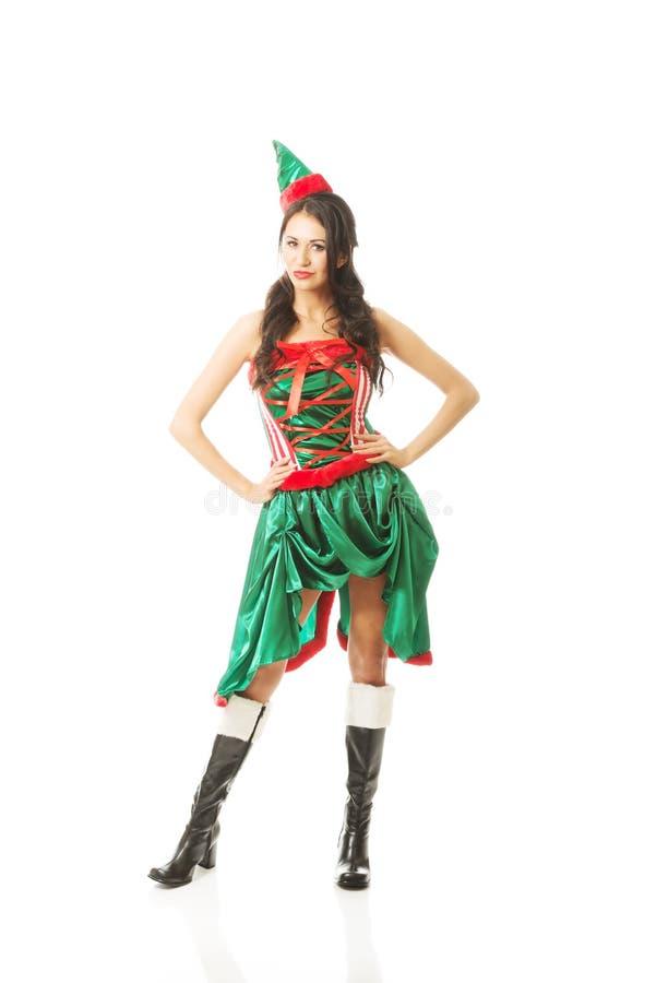 Эльф полнометражной красивой женщины нося одевает, касающся ее бедрам стоковое изображение