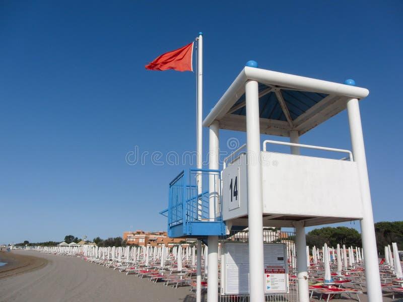 Эмблема революции для бурного моря над башней личной охраны длиной итальянское стоковые изображения rf
